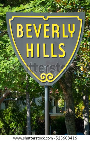 HOLLYWOOD, CALIFORNIA - OCTOBER 11, 2011 - Beverly hills sign in Los Angeles park on October 11, 2011 in Los Angeles, USA. The Beverly Hills Shield greets visitors along Santa Monica Blvd.