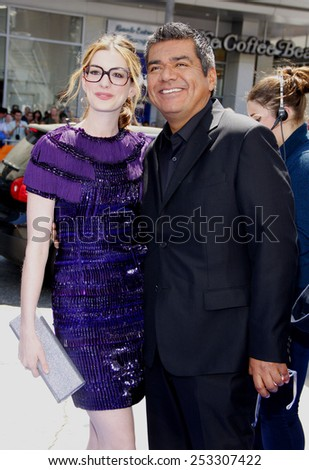 """HOLLYWOOD, CALIFORNIA - Sunday April 10, 2011. Anne Hathaway and George Lopez at the Los Angeles premiere of """"Rio"""" held at the Grauman's Chinese Theater in Los Angeles. - stock photo"""