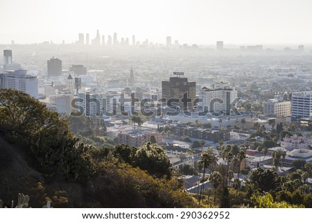 HOLLYWOOD, CALIFORNIA, USA - January 1, 2015:  Smoggy haze filled morning sky above Hollywood and downtown Los Angeles in Southern California.   - stock photo