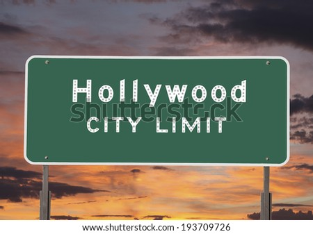 Hollywood city limits sign with sunset sky. - stock photo