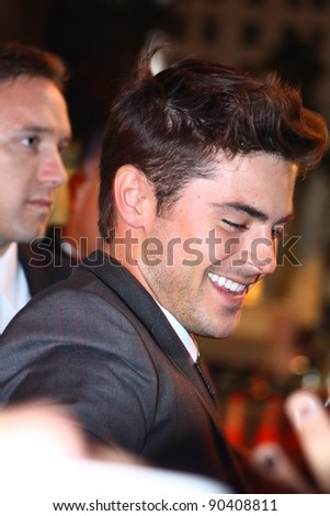 HOLLYWOOD - DEC 5: Actor Zac Efron signs autographs at the premiere of the movie New Year's Eve at Grauman's Chinese Theatre December 5, 2011 Hollywood, CA. - stock photo