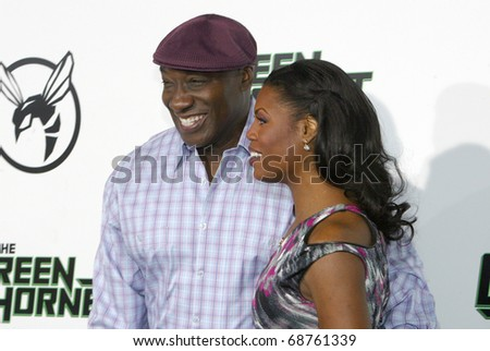"""HOLLYWOOD - JAN. 10:  Michael Clarke Duncan & Omarosa Manigaulk Stallworth arrive at the """"The Green Hornet"""" premiere at Grauman's Chinese Theatre on Jan. 10, 2011 in Hollywood, CA. - stock photo"""