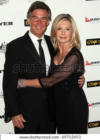 HOLLYWOOD - JAN 22:  Olivia Newton John & husband John arrives at the 2011 G'Day USA Los Angeles Gala on January 22, 2011 in Hollywood, CA - stock photo