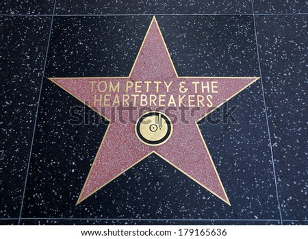 HOLLYWOOD - JANUARY 23: Tom Petty & the Heartbreakers star on Hollywood Walk of Fame on January 23, 2014 in Hollywood, California. This star is located on Hollywood Blvd. one of 2400 celebrity stars. - stock photo