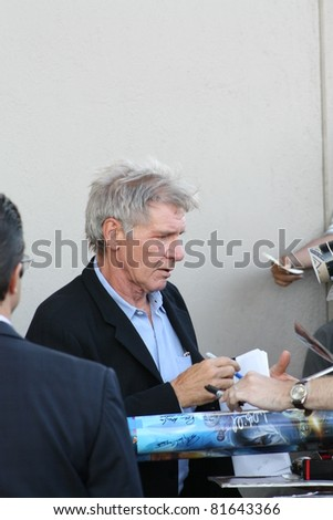 HOLLYWOOD - JULY 25:  Cowboys and Aliens star Harrison Ford signs autographs outside the Jimmy Kimmel Studios after an appearance on the Jimmy Kimmel show on July 25, 2011 in Hollywood, CA.