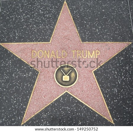 HOLLYWOOD - JULY 11: Donald Trump's star on Hollywood Walk of Fame, as seen on July 11, 2013 in Hollywood in California. This star is located on Hollywood Blvd. and is one of 2400 celebrity stars. - stock photo