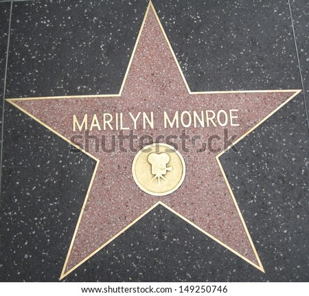HOLLYWOOD - JULY 11: Marilyn Monroe's star on Hollywood Walk of Fame, as seen on July 11, 2013 in Hollywood in California. This star is located on Hollywood Blvd. and is one of 2400 celebrity stars. - stock photo