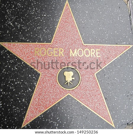 HOLLYWOOD - JULY 11: Roger Moore's star on Hollywood Walk of Fame, as seen on July 11, 2013 in Hollywood, California. This star is located on Hollywood Blvd. and is one of 2400 celebrity stars. - stock photo