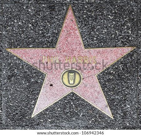 HOLLYWOOD - JUNE 26: Phil Harris star on Hollywood Walk of Fame on June 26, 2012 in Hollywood, California. This star is located on Hollywood Blvd. and is one of 2400 celebrity stars. - stock photo