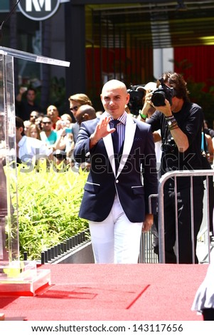 HOLLYWOOD - JUNE 20, 2013: Pitbull attends Walk of Fame ceremony where Jennifer Lopez received the 2500th star in front of the W Hotel June 20, 2013 Hollywood, CA. - stock photo