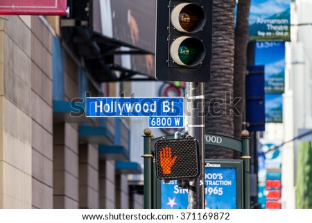 HOLLYWOOD, LOS ANGELES - SEPTEMBER 11: Views of the Walk of Fame and the Buildings at the Hollywood Boulevard on September 11, 2015. This street is an icon for the Movie industry in Hollywood. - stock photo