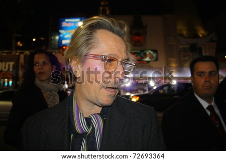 "HOLLYWOOD - MARCH 6: Actor Gary Oldman arrives at the premiere of the movie ""Red Riding Hood"" at Graumans Chinese Theatre on March 7, 2011 in Hollywood, CA. - stock photo"