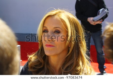 HOLLYWOOD - MARCH 7: Desperate Housewife Felicity Huffman chats with fans at Walk of Fame ceremony where she and husband William H. Macy receive stars on March 7, 2012 inHollywood, CA. - stock photo