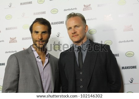 "HOLLYWOOD - MAY 9, 2012: Producer Ben Silverman(l) and Morgan Spurlock(r) walk the red carpet for the premiere of the movie ""Mansome"" held at the Arclight Theatre May 9, 2012 Hollywood, CA. - stock photo"