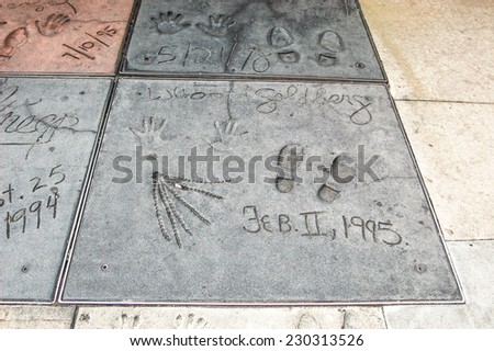 HOLLYWOOD - MAY 12: Whoopi Goldberg's handprints in Hollywood Boulevard on May 12,2012 in Hollywood. There are nearly 200 celebrity handprints in the concrete of Chinese Theatre's forecourt. - stock photo