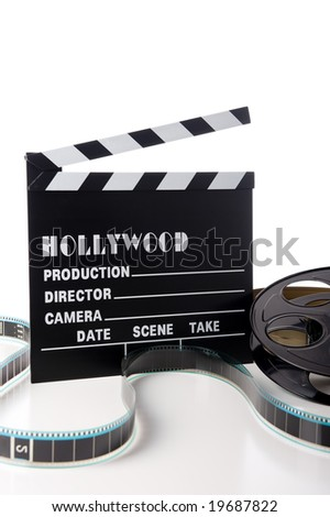 Hollywood movie items including a clapboard and a movie reel and tin on a white background - stock photo