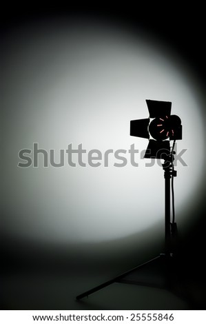 Hollywood movie light with barn doors, shadows and stand - stock photo
