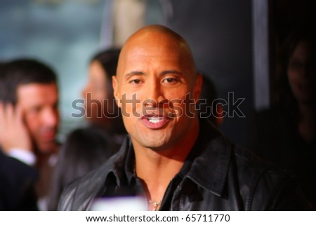 HOLLYWOOD - NOVEMBER 22: Actor Dwayne Johnson at the premiere of his movie Faster at Grauman's Chinese Theatre November 22, 2010 in Hollywood, CA. - stock photo
