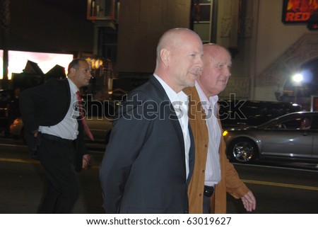 HOLLYWOOD, OCTOBER 11: Actor Bruce Willis (L) arrives at a special screening of Summit Entertainment's 'RED' at Grauman's Chinese Theatre on October 11, 2010 in Hollywood, California.