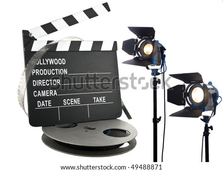 hollywood slate with film reel and lights - stock photo