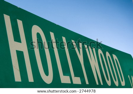 Hollywood street sign with blue sky behind - stock photo