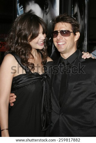 "HOLLYWOOD. Thursday May 4, 2006. Katie Holmes and Tom Cruise attend the Los Angeles Fan Screening of ""Mission: Impossible III"" held at the Grauman's Chinese Theatre in Hollywood, United States. - stock photo"