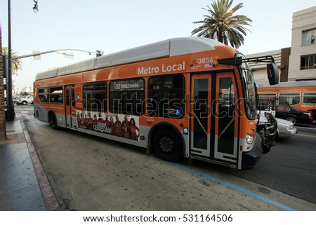 HOLLYWOOD - WEDNESDAY, NOVEMBER 16, 2016: An orange colored  Los Angeles Metro Bus travels on its route.