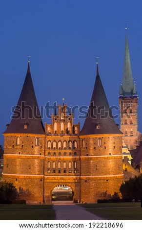 Holstein gate and Petri church by night in Lubeck, Germany - stock photo