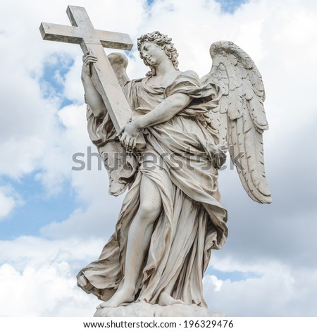 Holy angel with a cross at Ponte Sant'Angelo, Rome, Italy, 2014 - stock photo