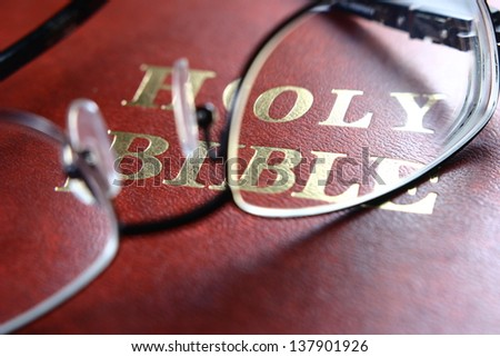 Holy Bible, Eye Glasses A photo of a bible, eye glasses. - stock photo