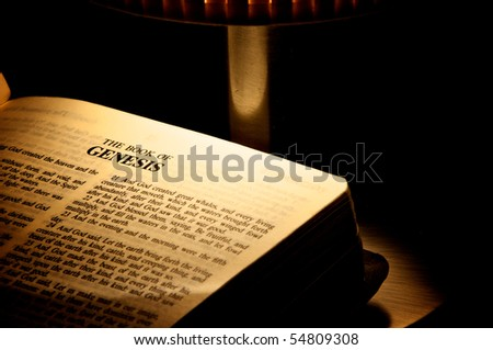 Holy Bible open at the lamp - stock photo