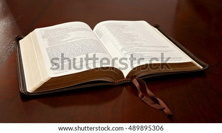 Holy Bible Open on a Wooden Table