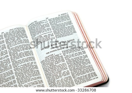 holy bible open to the second book of kings commonly called the fourth book of kings,  on white