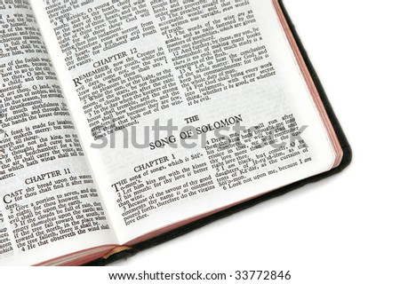 holy bible open to the song of solomon,on white background