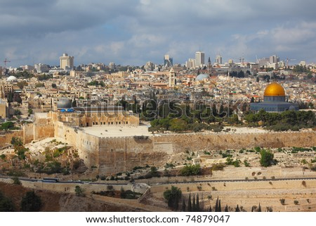Holy City of Jerusalem. The magnificent panorama of the city. Dome of the Rock, Omar Mosque and the Dome of the Holy Sepulcher. In the background - modern skyscrapers and cranes newly - stock photo