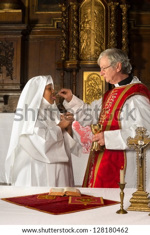 Holy communion in the 17th century interior of a medieval church - stock photo