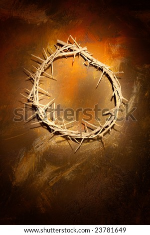 Holy crown of thorns hanging on a grungy wall at Easter - stock photo