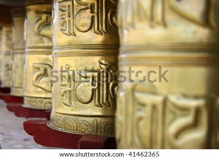 Holy golden praying wheels - stock photo