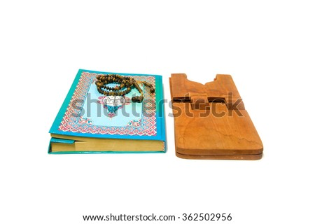 Holy Quran and prayer beads and stand with white background