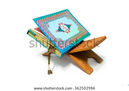 Holy Quran and prayer beads on stand with white background  - stock photo
