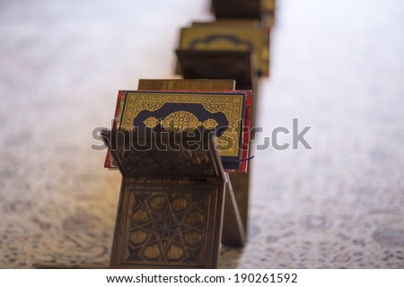 Holy Quran books in a row standing on rahle (lectern) - stock photo