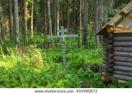 Holy spring of Saint Nicholas in the thickets of the forest, near the town of Pestyaki, Ivanovo oblast, Russia. - stock photo