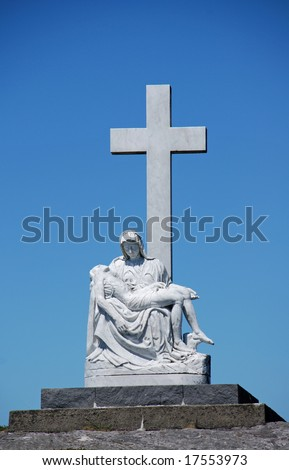 Holy virgin Mary and Jesus on an Irish hill, the sculpture looks like a copy from the Pieta of Michelangelo - stock photo