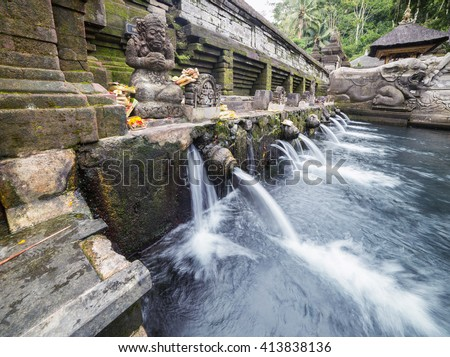 Holy water at Pura Tirta Empul Ubud Bali, Indonesia. - stock photo