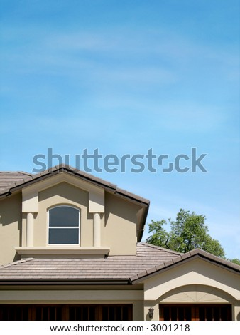 Home against large blue sky; copyspace - stock photo