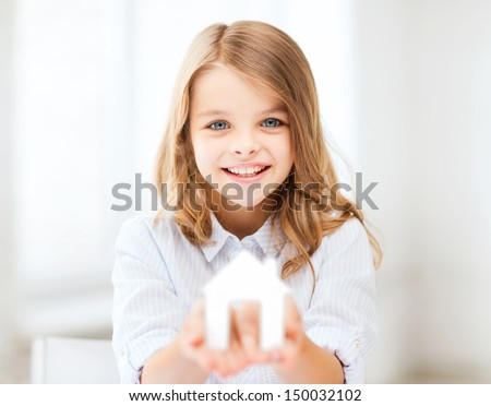 home and family concept - little girl holding white paper house - stock photo
