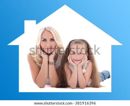home and family concept - young mother with her little daughter lying on the floor