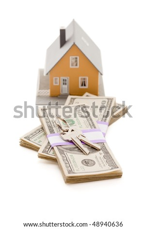 Home and House Keys on Stack of Money Isolated on a White Background - Cash for Keys Program. - stock photo
