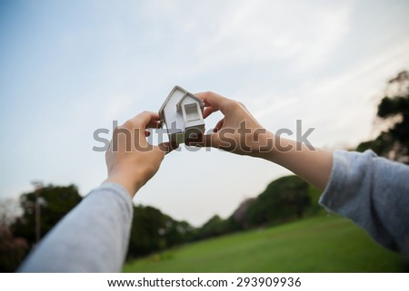 Home artificial on the green grass. - stock photo