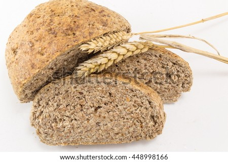 Home baked brown bread slices on the wooden table